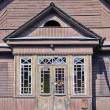 Stock Photo: Old derelict wooden house facade
