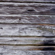Ancient wooden log wall background — Stock Photo