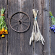 Wheat and medical herbs bunch on old wooden wall — Stock Photo
