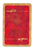 Old dirty used playing card red paper cover — Stock Photo