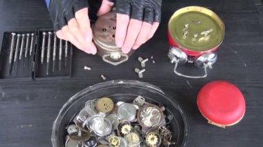 Clockmaker hands repairing old alarm-clock — Wideo stockowe