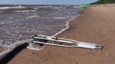 Pair crutch on sea beach sand — Stock video