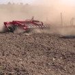 Agriculture tractor on autumn farm field with cultivator — Stock Video