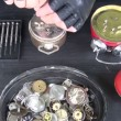 Stock Video: Clockmaker repairing old alarm-clock
