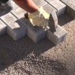 Worker making sidewalk pavement with stone bricks — Stock Video