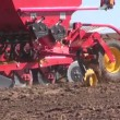 Agriculture machine sowing seeds and cultivating field — Stok video