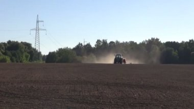 Agriculture tractor sowing seeds on farm field — Stock Video