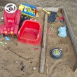 Old playground childrens sandbox with toys — Stock Photo