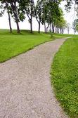 Gravel pathway in summer park — Stock Photo