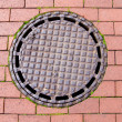Foto de Stock  : Street canalization steel manhole on pavement