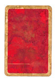 Old dirty playing card red paper cover — Stock Photo