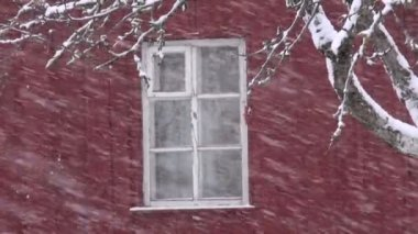Winter  snow falling on  house window and wall background — Stock video