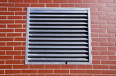 Metal grate on new wall — Stock Photo