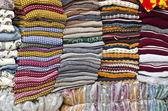 Colorful stacked fabric in  big market , India — Photo