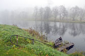 Autumn mist and boat in river — Stock Photo