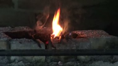 Fire in old smithy and various blacksmith tools — Stockvideo