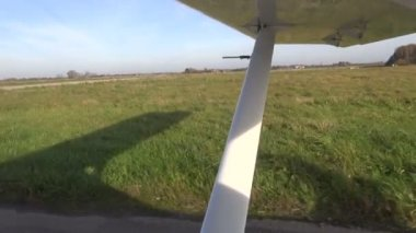 Small airplane aircraft wing on airfield — Stock Video