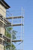 Scaffold near repair house wall corner — Foto de Stock