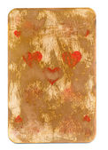 Old playing card used background with hearts symbols — Stock Photo