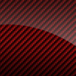 Red glossy carbon fiber background or texture - Stock Photo