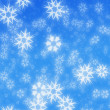Blue snowflakes winter background — Stock Photo