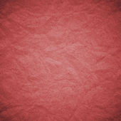 Textured obsolete crumpled packaging red paper — Stock Photo