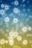 Colorfiul blue and yellow snowflakes winter background — Stock Photo