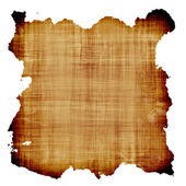 Old parchment paper against white background — Stock Photo