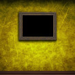 Old wooden frame on yellow retro grunge wall - Стоковая фотография