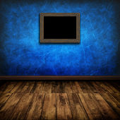 Dark vintage room with wooden floor and old frame on the wall — Fotografia Stock