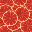 Red background with citrus-fruit of grapefruit slices — Stock Photo