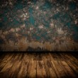 Grunge industrial interior with wooden floor and old damaged wal — Stock Photo