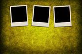 Blank instant photo frames on grunge yellow background — Stock Photo