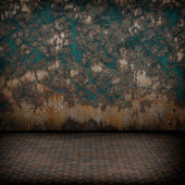Grunge industrial interior with metal floor and old damaged wall — Stock Photo