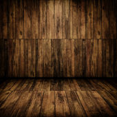 Grunge cabin interior with a wooden wall and floor — Stock Photo