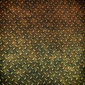 Grunge metal diamond plate background or texture — Stockfoto