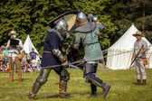 CHORZOW,POLAND, JUNE 9: Fight of medieval knights during a IV Co — Stock Photo