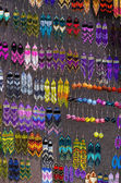 Colourful handmade earrings on a market stall — Stock Photo