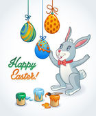 Easter card with bunny decorating eggs with brush and colors. Happy Easter greeting card for kids — Stock Vector
