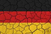 Flag of Germany over cracked background — Stock Photo