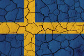 Flag of Sweden over cracked background — Stock Photo