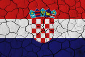 Flag of Croatia over cracked background — Stock Photo