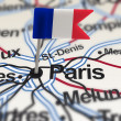 Pin with flag of France in Paris - Stock Photo