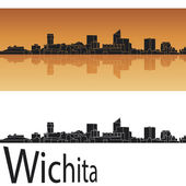 Wichita skyline in orange background — Stock Vector