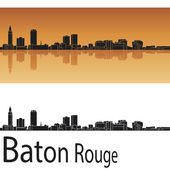 Baton Rouge skyline in orange background — Stock Vector