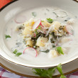 Summer potato soup with radish and kohlrabi - Stock Photo