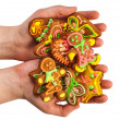 Gingerbread held in the hand — Stock Photo