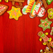 Gingerbread, Christmas cookies, top view, red background - Stock Photo