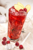 Red drink with raspberries, ginger and ice — Stock Photo