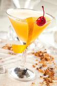 Yellow drink with passion fruit — Stock Photo